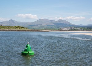 Along the winding way into Porthmadog harbour with the magnificent back-drop of the Snowdon range of mountains
