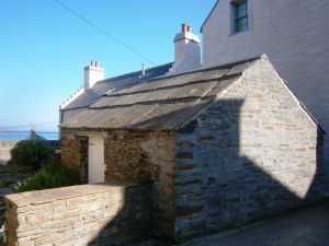 Some of the older buildings have sandstone slabs for rooves - such as this restored shed