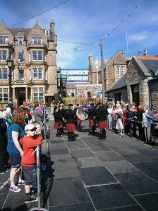 "At last - a pipe band! At the Stromness ""Shopping Week"" awaiting the Shopping Week Queen coming to be crowned via the lifeboat"