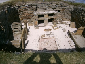 Later period house from about 3500 years ago. Stone beds each side, fireplace in the centre and stone dresser on the far side.