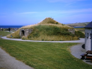 Modern mock up of a Skara Brae house with tunnel access passageways and turf covered roof (much like the rooves of traditional Skandanavian houses).