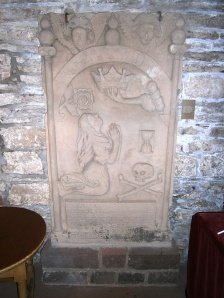 Graphic 17th century tombstones adorn the side walls of the Cathederal